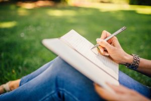 Photo of someone writing in a journal