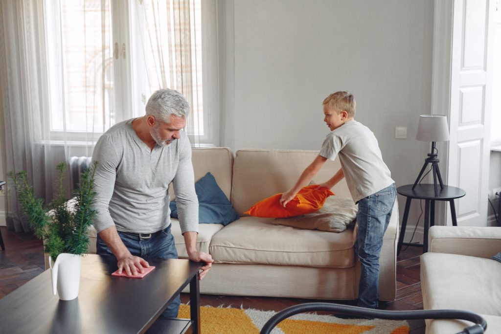 Photo of Father and Son Cleaning